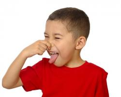 Child pinching his nose at a bad smell