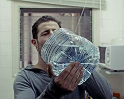 Man chugging water