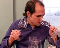 Man sniffs wine