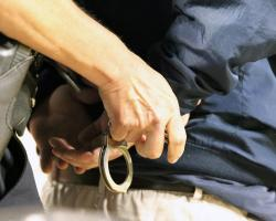 Police officer handcuffing a man