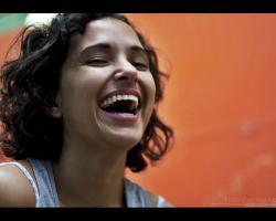 Woman laughing, orange background