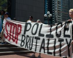 Young people carrying hand-painted signs in a rally against police brutality.