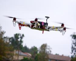 a drone flying above a line of rooftops