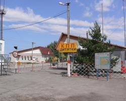 "Entrance to the Chernobyl Exclusion Zone at Checkpoint ""Dityatki"""