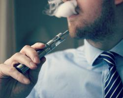 Man vaping with an e-cigarette