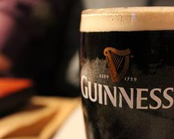 a pint of foamy Guinness beer