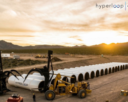 Sections of Hyperloop track being assembled. Sunset in the desert