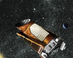 Artist's rendition of Kepler spacecraft with distant solar system