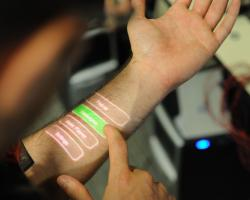 Skinput system using button-driven interface, wearable tech