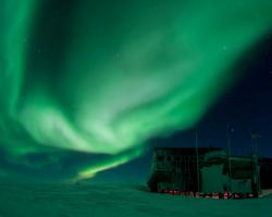 Aurora borealis above the IceCube Lab at the South Pole.