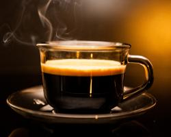 Steaming cup of hot coffee