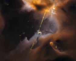light saber-like stream of light from a newborn star