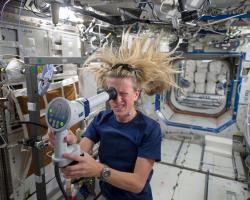 Astronauts Karen Nyberg uses a fundoscope aboard the International Space Station