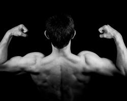 Man flexing shoulder muscles, biceps