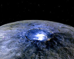 Bright spot in a crater on the surface of Ceres, a dwarf planet. surrounding area is glowing indigo.