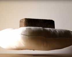 Pillow levitating with brick on top