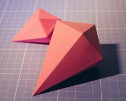 Origami, diamond shaped, on grid paper.