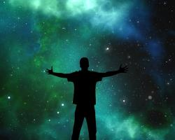Silhouette of a person against the cosmos