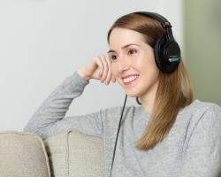 Woman listening to headphone