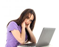 Frustrated girl on laptop