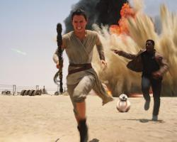 Screenshot of characters running away from an explosion in Star Wars: The Force Awakens