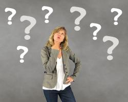 Woman puzzling with question marks around her head